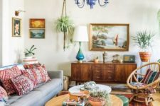 10 a boho meets mid-century modern living room with bright printed pillows, a rug and colorful furniture