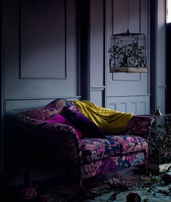 a colorful floral chair or sofa will add color and chic to your moody space and make it catchier