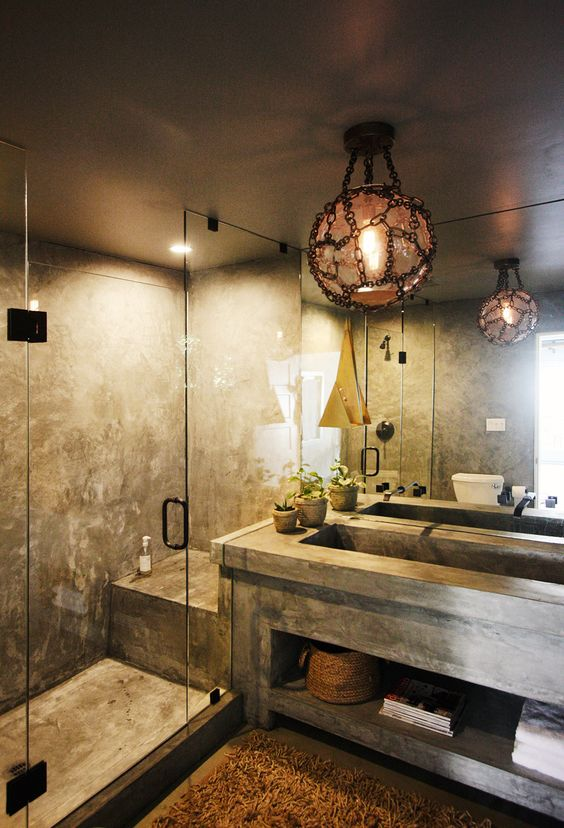 a stone and concrete bathroom with dim lights is a relaxation oasis   choose different lights