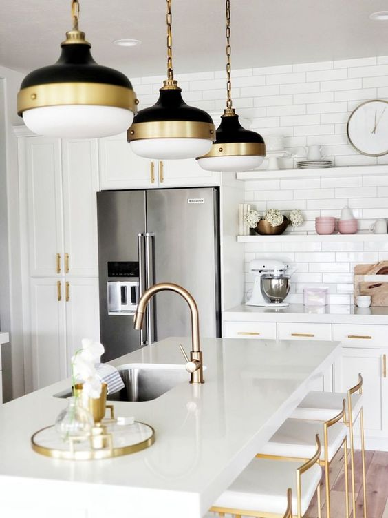 chic gold fxitures, gold touches on the lamps and gold stools to spruce up a neutral space