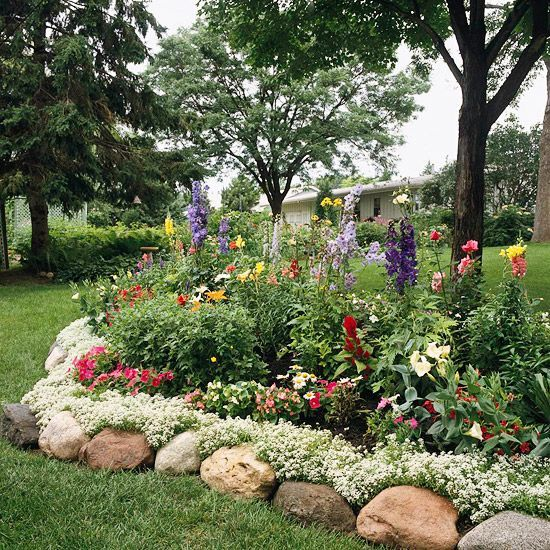 large rocks are a nice idea to highlight your garden beds and they bring a natural feel to the space