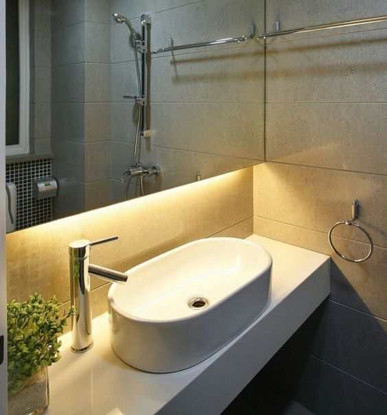strip lighting attached to a mirror cabinet over the sink is a stylish modern decor idea for a bathroom
