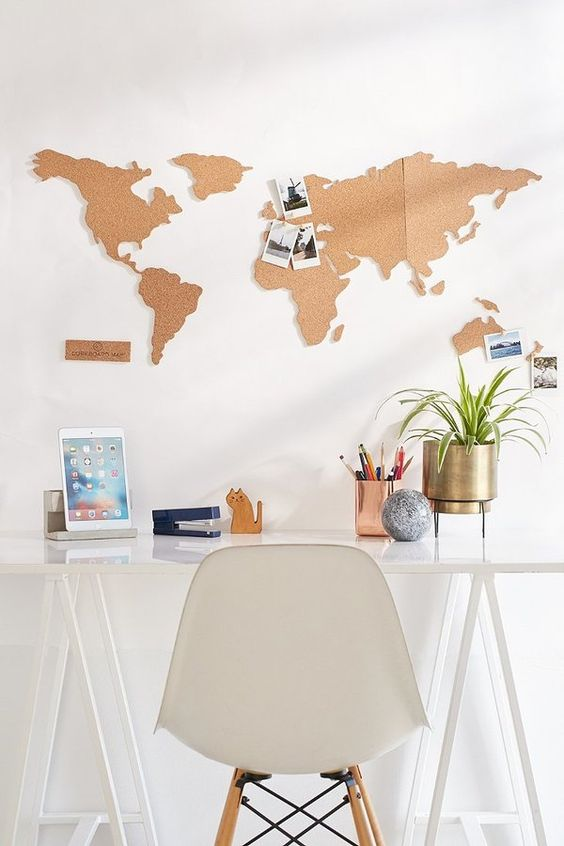 a cork board world map over the desk is a very fun and cool idea - a functional piece that doubles as decor