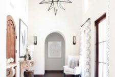 11 a neutral and light-filled entryway with an oversized star-shaped chandelier for a statement