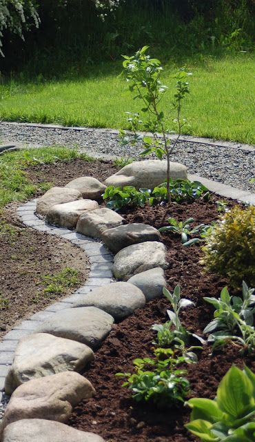 large rough rocks doubled with bricks make the garden look elegant and natural at the same time