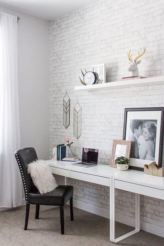 a boho meets mid-century modern home office nook is made catchier with white brick and artworks