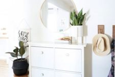 12 a geometric framed chandelier with brass touches adds chic to the entryway lighting it up