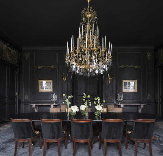 a large vintage chandelier over the moody dining room is a gorgeous idea for more light and to highlight the decor