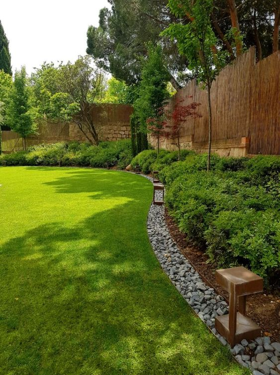 rock edging adds texture to the landscape design and separate the shrubs and the lawn