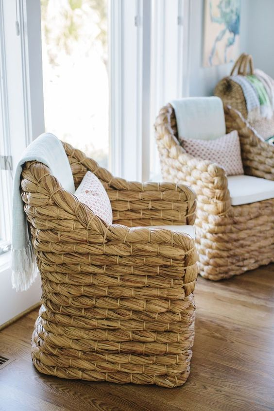woven accent chairs are ideal for a contemporary coastal space, they bring an outdoor feel at once