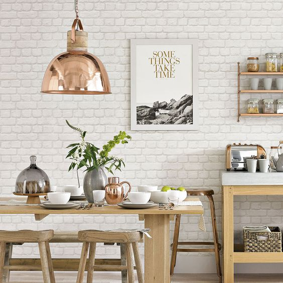 a Scandinavian kitchen with a white brick wall and neutral furniture, copper touches for a serene feel