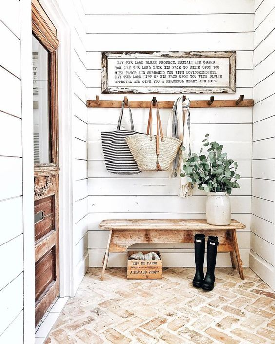 a cozy farmhouse entryway done with white shiplap plus a brick floor is a very chic and budget friendly idea