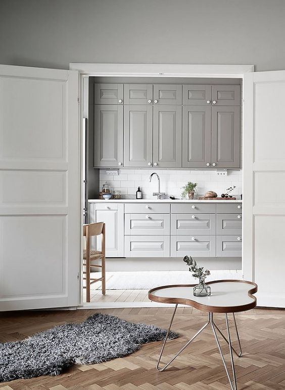a grey kitchen is a huge trend as grey is the new black and it looks soothing and relaxing