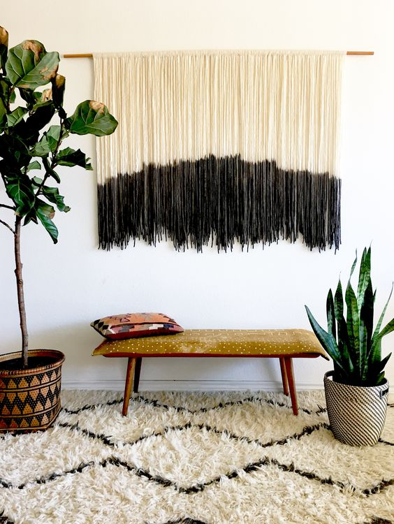 a long dyed fringe wall hanging in black and white is a calm boho decoration