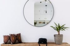 13 a round mirror is a trendy decoration and a piece that doubles the light coming to the entryway