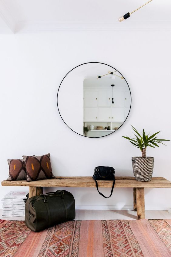 a round mirror is a trendy decoration and a piece that doubles the light coming to the entryway