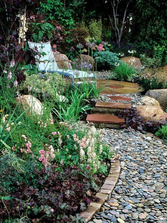 brick edging and a pebble path is a stylish idea - you'll get a natural feel and a touch of well-grooming at the same time