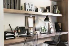 13 built-in shelves and a built-in desk for a shared minimalist home office, which won't take much space