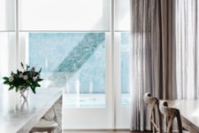 13 neutral roller shades look very well with curtains of any color and texture blocking excessive light
