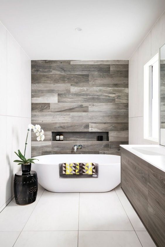 a contemporary bathroom with reclaimed wood touches and negative space for a relaxing feeling