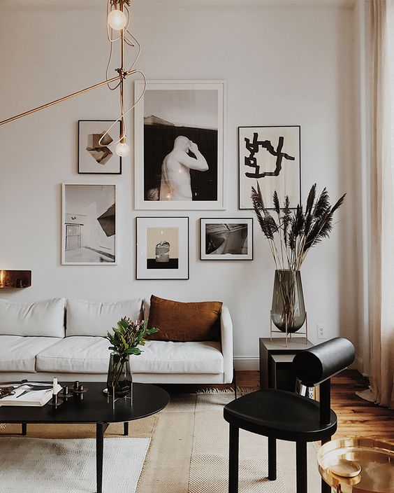 a monochromatic gallery wall for accenting a simple black and white space