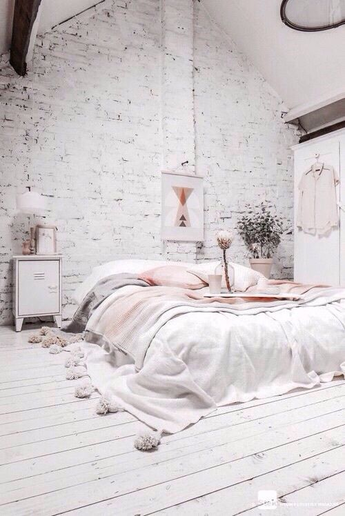 a white brick statement wall makes the girlish bedroom more Nordic and harsh