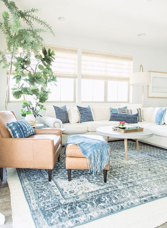 incorporate some comfortable leather and upholstered furniture into your coastal living room