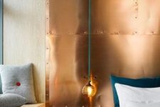 14 mixing cold and warm hues is a bodl idea, here a copper wall is paired with emerald bedding and grey pillows