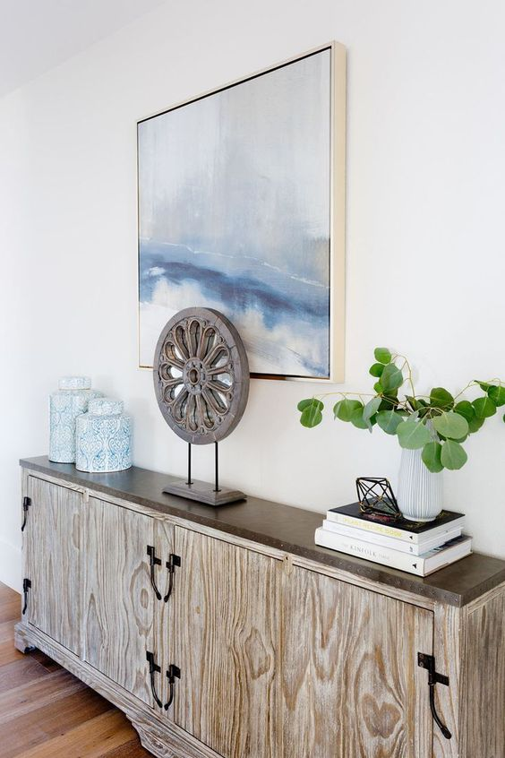a very sleek plywood and wood console table for a contemporary coastal entryway