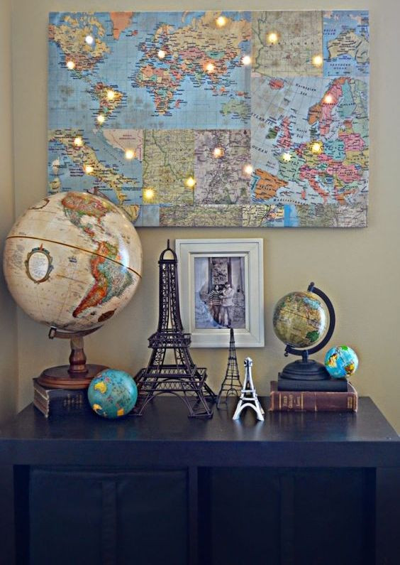a world map collage with LED lights in the places where you've already been is a very inspiring wall art idea