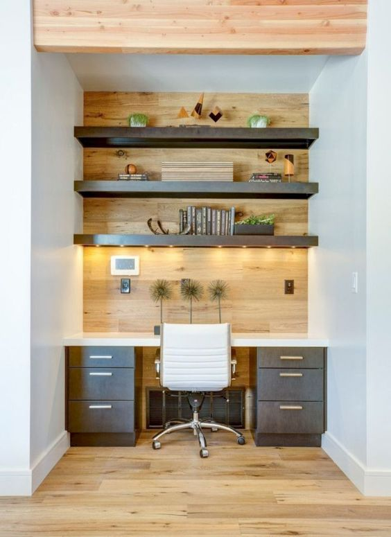 add more light to a home office nook attaching strip lighting to the shelves over your desk