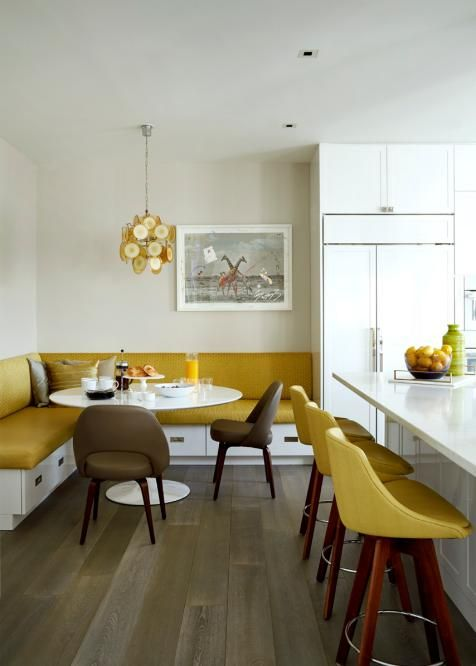 infuse your kitchen and dining space with color - go for mustard stools and an upholstered bench plus a chandelier