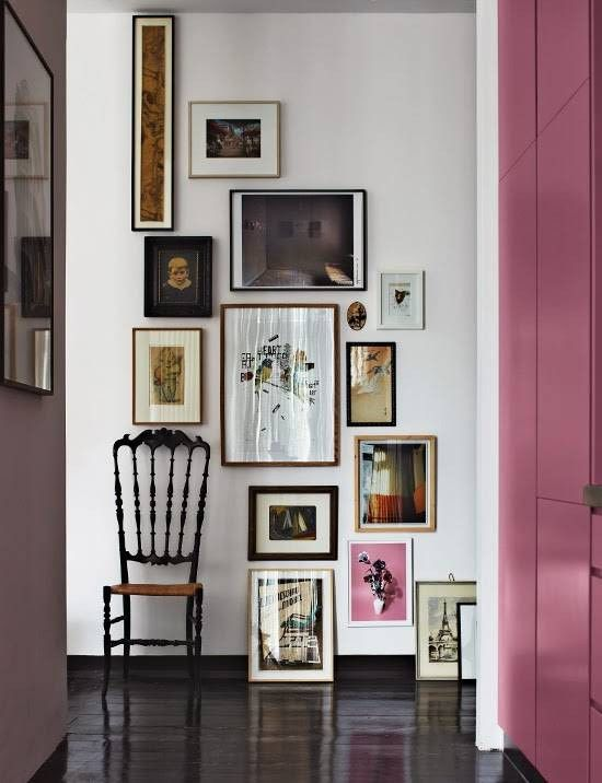 a catchy floor to ceiling gallery wall with mismatching frames and a very narrow artwork will make a statement