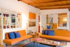 16 a super bright orange and blue living room calmed down with neutrals is a bold idea