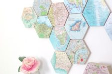 16 a world map of hexagon tiles that show the places where youve been and a city map clock to match