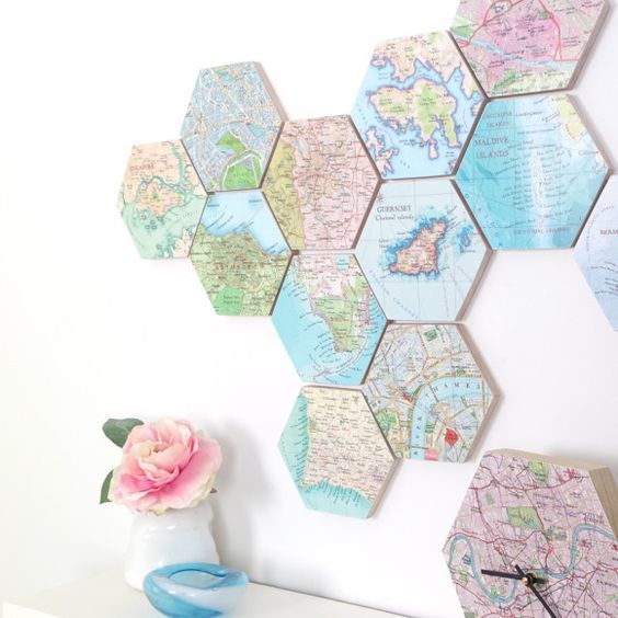 a world map of hexagon tiles that show the places where youve been and a city map clock to match