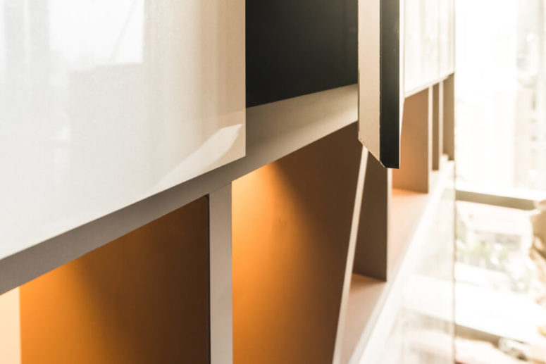 accent your prized pieces with strip lighting in display shelving - what an easy and cool idea