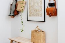 16 an artwork, a hanging planter with greenery and even a straw bag and hat add to the decor of the space