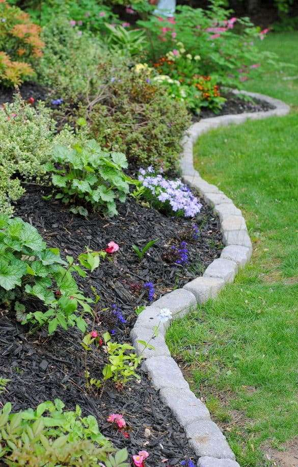 traditional stone edging always works for most of gardens - it's neutral and timeless, besides it's very durable