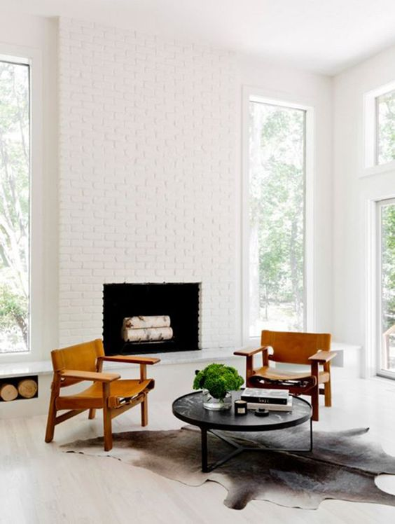 a chic mid-century modern nook with a white bricck clad fireplace that looks bright and chic