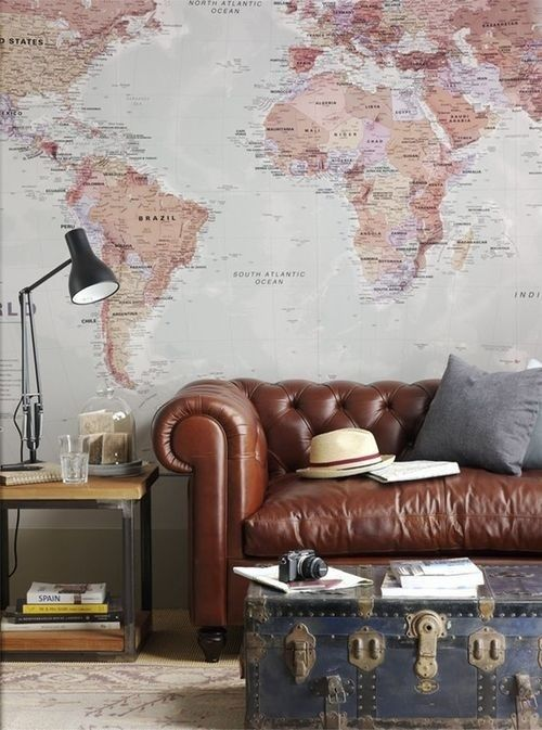 a large wall mural in a vintage meets boho living room is a beautiful and chic idea to try