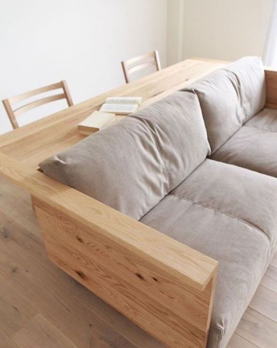a sofa with a desk or console attached to the back is a cool way to save some space