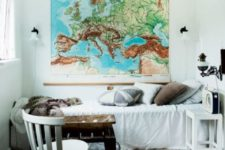 18 a vintage industrial guest bedroom with a large map as an artwork that inspires travelling