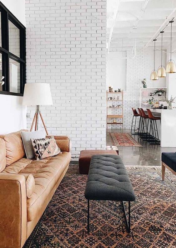 white brick walls in an open layout tie up the spaces and make the whole layout more cohesive