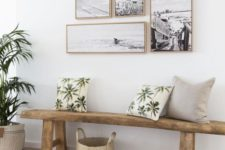 19 a coastal entryway with a beach-inspired gallery wall and some tropical pillows for a match