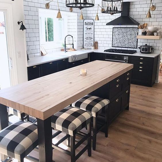 a farmhouse kitchen in black and white with buffalo check printed stools
