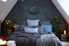19 a moody attic bedroom is refreshed with candles and lights hanging over the bed itself