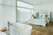 20 a bathtub in the bedroom is a hot trend, so you may organize your space like that, too