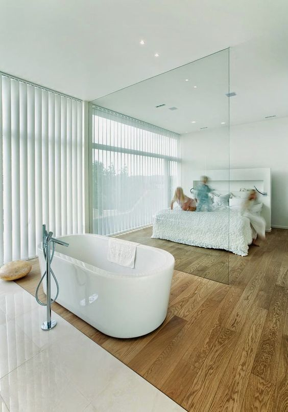 a bathtub in the bedroom is a hot trend, so you may organize your space like that, too