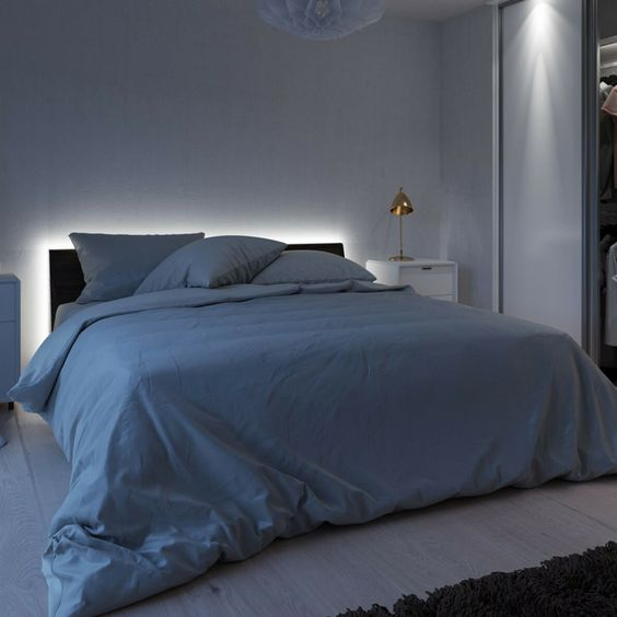 a bed with headboard with strip lighting creates a relaxed mood in the bedroom and you won't need any additional lamps